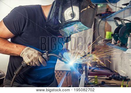 Man Weld A Metal Welding Machine