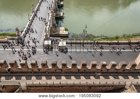 Rome Italy - August 19 2016: Crowd of tourists in bridge of Castel Sant Angelo. High angle view. The Mausoleum of Hadrian usually known as Castel Sant'Angelo is a towering cylindrical building in Rome