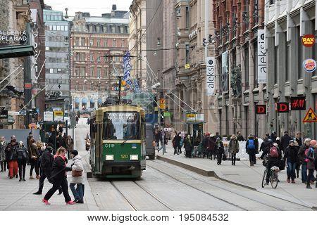 HELSINKI FINLAND - MARCH 17: tram on street of Helsinki Finland at March 17 2016. Tram in Helsinki is a widespread type of public transport