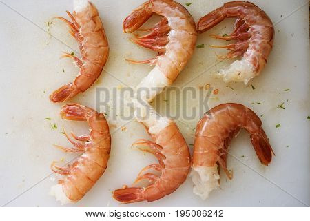 raw king prawns ready to be seared in pan