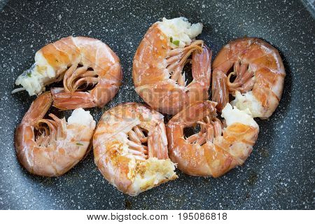 king prawns seared in pan with butter