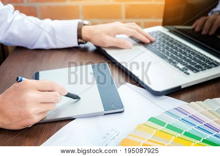 Hands Of Male Hipster Modern Graphic Designer In Office Working With Colour Samples. Man At Workplac