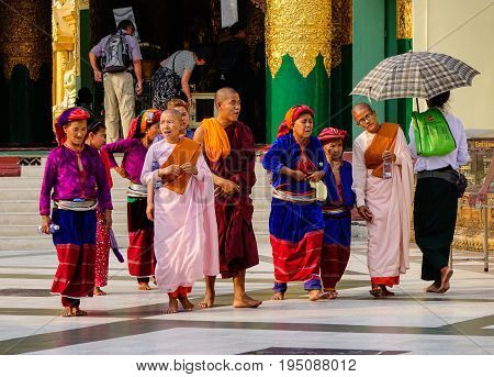 People Praying At Shwedagon Pagoda