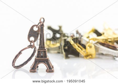 Souvenir key chain of mini eiffel tower (Tour Eiffel) white background.