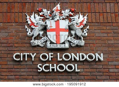LONDON, ENGLAND - May 24,2017: coat of arms of the City of London School (independent day school for boys) on a brick facade in London, UK