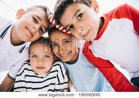 Close-up Portrait Of Happy Multiethnic Kids Standing Together And Smiling At Camera