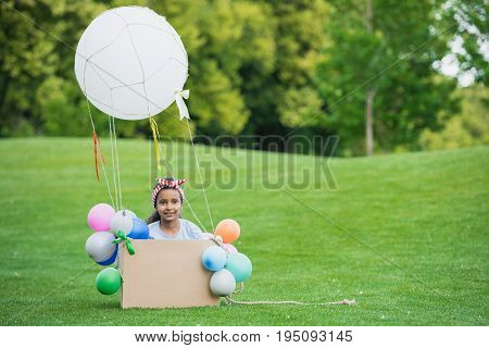 Adorable Little African American Girl Playing With Diy Hot Air Balloon In Park