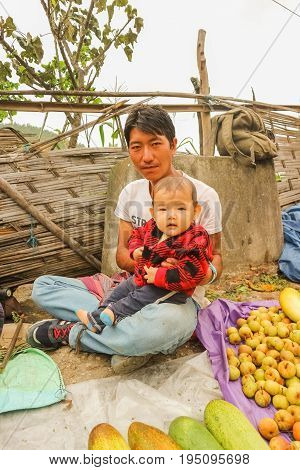 Lobesa Village, Punakha, Bhutan - September 11, 2016: Unidentified Man With His Baby On His Lap At W