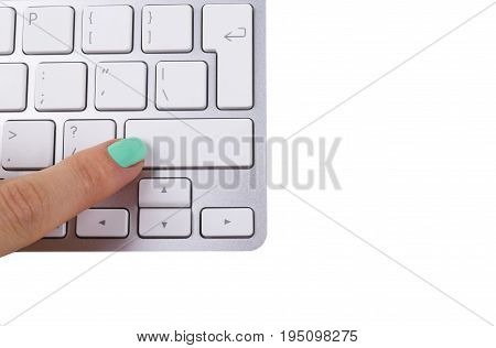 Close up view of a Finger Pushing on a Button of computer Keyboard. Finger Pressing a Slim Aluminium Keyboard Button.Modern Laptop Keyboard. Empty space for text