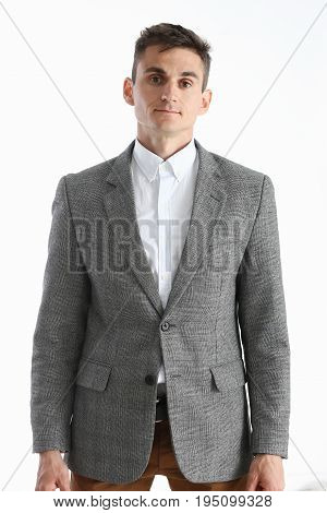 Portrait Of A Handsome Young Man In A White Shirt And Suit