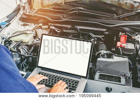 Professional Car Mechanic Working In Auto Repair Service Using Laptop Bon Car