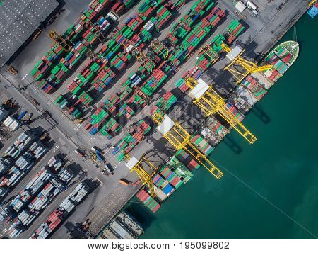 Container box loading by crane Vessel boat in logistic port transportation delivery and business concept.