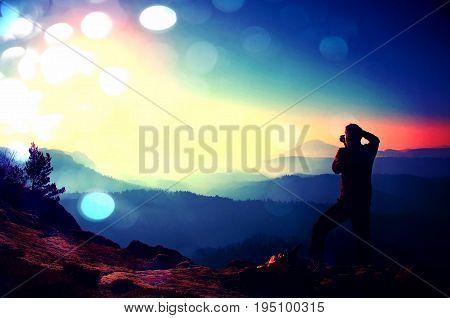 Film Grain. Professional Photographer Takes Photos With Mirror Camera On Peak Of Rock. Dreamy Fog