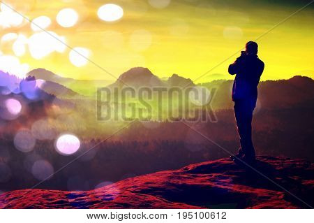 Film Grain. Photographer Takes Photos With Big Camera On Peak Of Rock. Dreamy Misty Landscape, Hot S