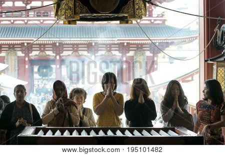 Women praying at the Senso-ji temple. April 14 2014 - Asakusa, Tokyo, Japan