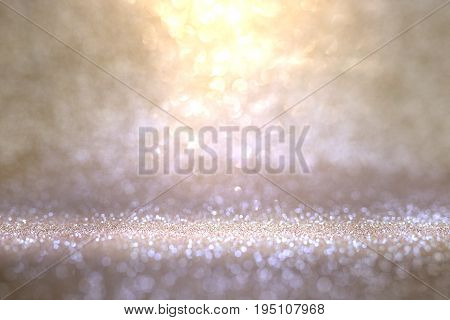 Abstract gold violet background with glittering bokeh effects for a celebratory concept