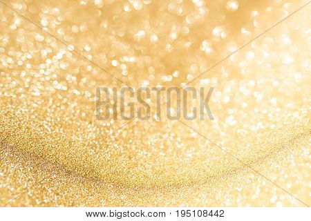Abstract golden background with bright bokeh effects for a festive wedding concept