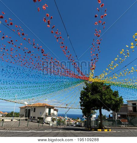 PONTA DELGADA PORTUGAL - SEPTEMBER 10 2016: Garlands street decorations at Madeira Wine Festival in Ponta Delgada Madeira Portugal. The Madeira Wine Festival honors the grape harvest with a celebration of traditional local heritage and wine production.