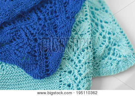 Knitted fabric of dark blue and light blue color. Knitwear