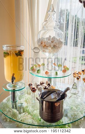 Lemonade In Glass Bar, Macaroons And Marshmallows Stand Served On The Tired Table