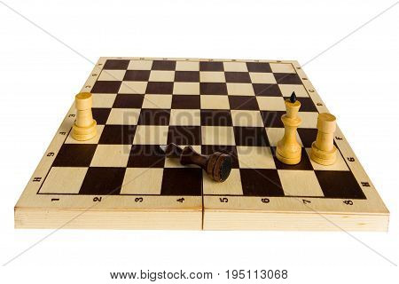 Endgame. The black chess king is defeated and lies on the board.