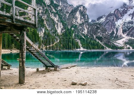 Lake Braies also known as Lago di Braies. The lake is surrounded by the mountains which are reflected in the water.1st point of the trekking route Alta Via 1, The Dolomites, Alps, South Tyrol, Italy.