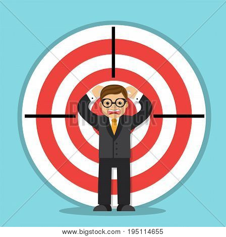 Scared businessman stands and screams in the center of the target