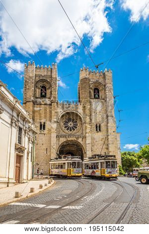 LISBON,PORTUGAL - MAY 18,2017 - View at the Cathedral of St.Mary Major with old trams in the streets of Lisbon. Lisbon is the capital of Portugal.