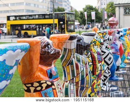 BERLIN GERMANY - JULY 3 2017: United Buddy Bears At Wittenbergplatz Square In Berlin With Bus In The Background Selected Focus