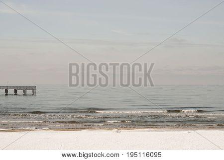 Baltic sea in winter, sea pier background