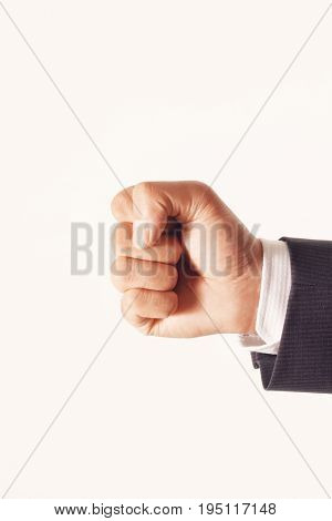 Closeup of hand with clenched fist against white background