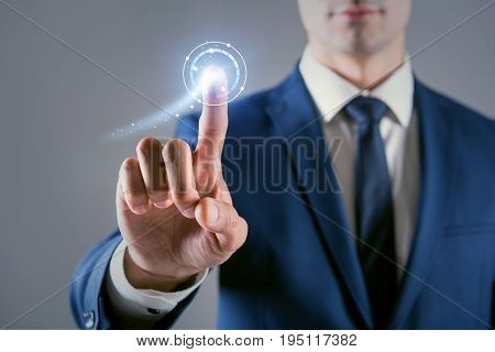 Cyberspace and virtual reality. Close-up of hand of pleasant businessman which is pressing digital button of modern touch screen
