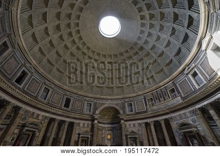 Pantheon in Rome. Ray of sunlight passing through a hole in the ceiling. Inside view. Pantheon was built as a temple to all the gods of ancient Rome. Rome Italy. June 2017