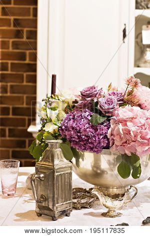 Hydrangeas. Beautiful purple hydrangea flowers close-up in a vase. A beautiful bouquet of flowers. Huge beautiful and fluffy pink hydrangea