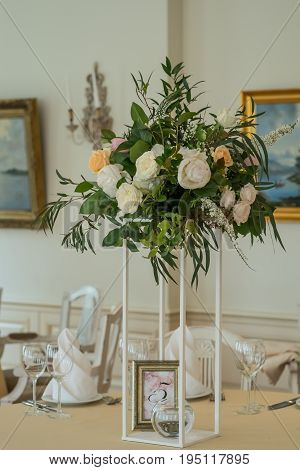 Decorated wedding table with flowers, dining set and the candle