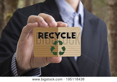 Businessman holding card message recycle reduce reuse. concept environmental natural ecology.