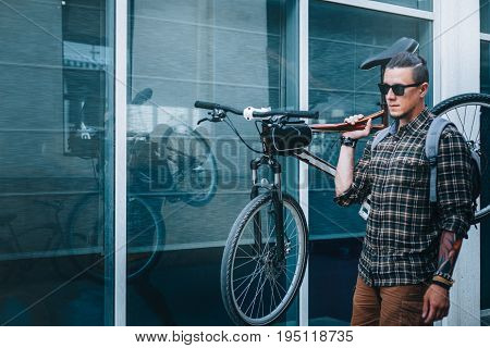 Handsome Young Man With Glasses Carries Bicycle On His Shoulder