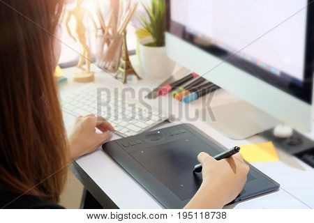 Graphic designer woman working on creative office with create graphic on computer.