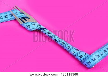 Fork In Metallic Color Wrapped Tight With Cyan Flexible Ruler