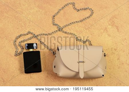 Handbag For Women And Black Bottle Of Scent, Top View