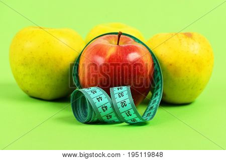 Composition Of Four Apples And Tape For Measuring