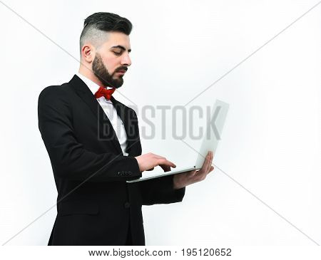 Businessman With Beard Or Director With Serious Face Holds Computer