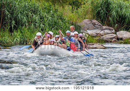 Village Myhia Mykolayiv region South Bug River Ukraine - July 9 2017: Rafting and kayaking. A popular place for extreme family and corporate recreation as well as training for athletes.