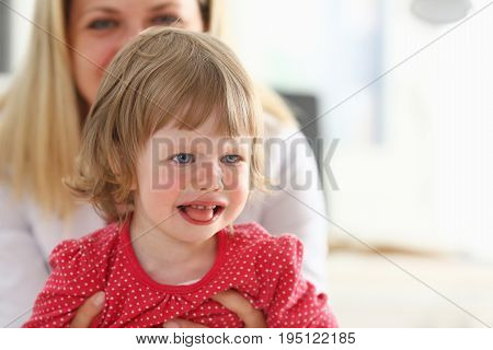 Little child at pediatrician reception. Physical exam appointment cute infant portrait baby aid healthy lifestyle ward round child sickness clinic test high quality and trust concept