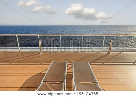 Cruise ship deck with sun loungers out at sea