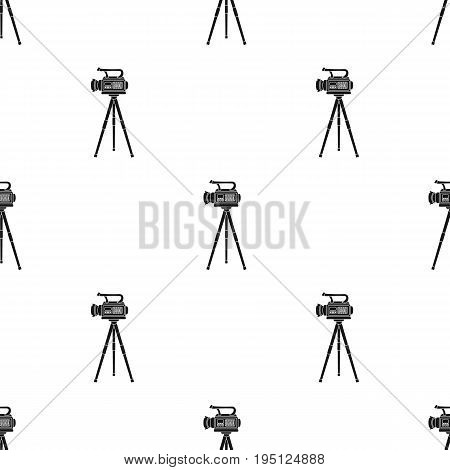 Movie camera on a tripod. Making a movie single icon in black style vector symbol stock illustration .