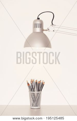 Desk Lamp and Pencils