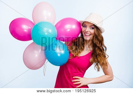 Woman Playing With Many Colorful Balloons