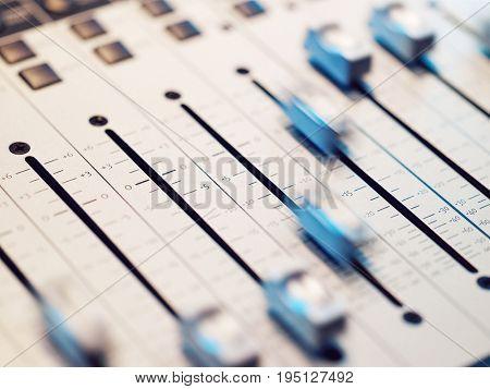 Closeup of mixing board in the recording studio