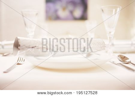 Closeup of Christmas cracker on place setting